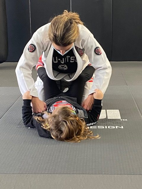 Mom and daughter training Jiu Jitsu